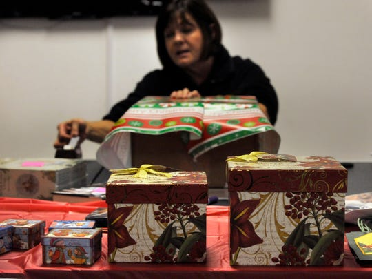 Marsha Ossowski pulls on a tape dispenser during the third-annual Christmas Craft Sale Dec. 2, 2016 at First United Methodist Church in Cross Plains. Sponsored by the Cross Plains Public Library, the sale also featured free gift wrapping.