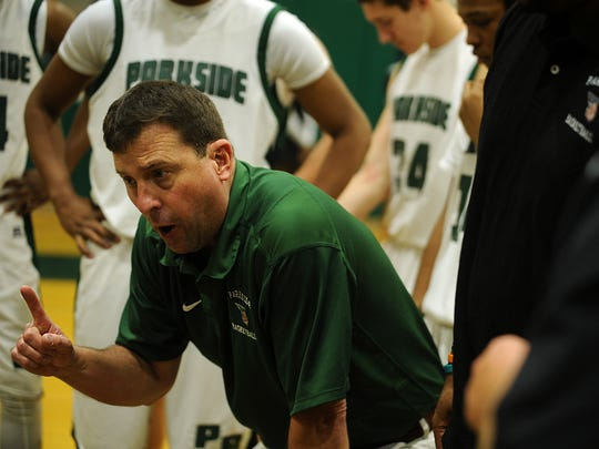 Parkside head coach David Byer talks to his team during