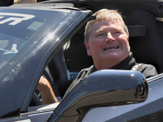 Sam Schmidt is all smiles after completing the semi-autonomous car race prior to the IndyCar Grand Prix at the Indianapolis Motor Speedway on May 13, 2017.