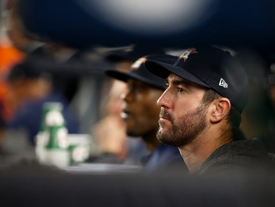Houston Astros' Justin Verlander watches from the dugout