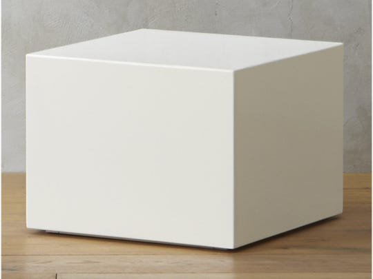 CB2's City Slicker ($199) a sleek, white modern cube that contrasts, but doesn't compete with, a table on the opposite side with a bit more detail.