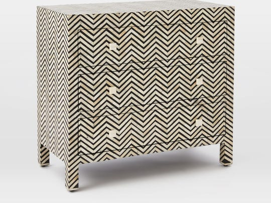 The Bone Inlaid-3-Drawer Dresser is a solid foundation for a vignette at the end of a hallway ($1,299, westelm.com).
