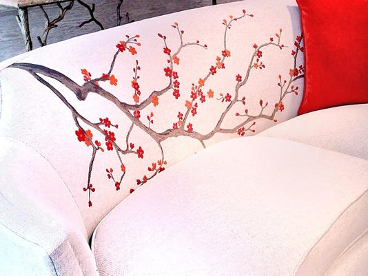 Asian influence, cherry blossoms settle on furniture