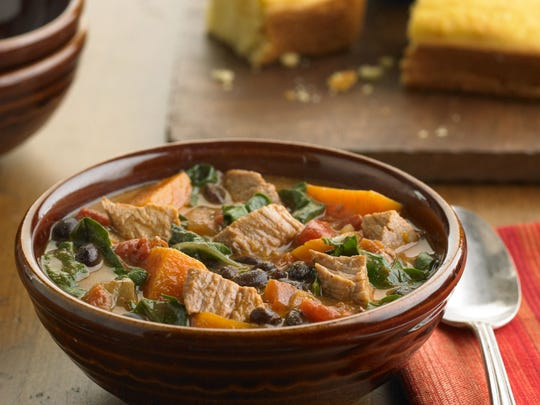 Pork, sweet potato and black bean stew is finished with a bunch of Swiss chard that's cooked until wilted but still bright green.