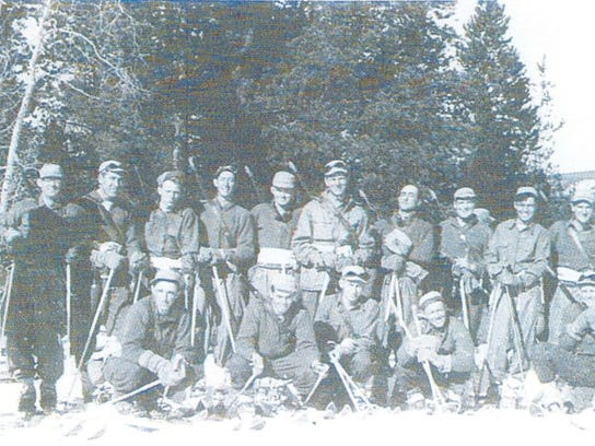 Soldiers pose for a group photo at the 10th Mountain