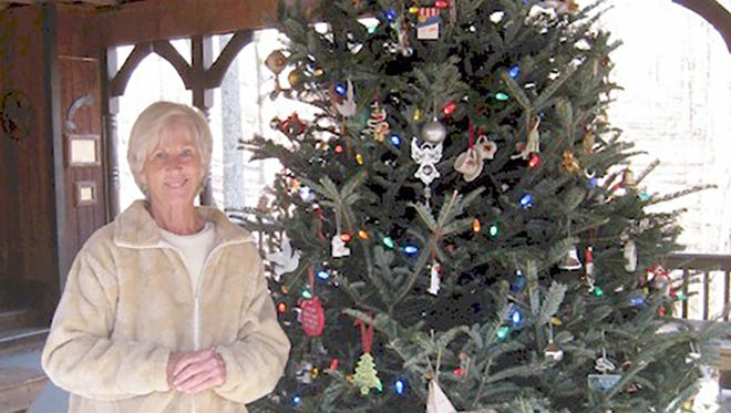 Janie Wells invites everyone to place an ornament on the Memory Tree in remembrance of a loved one lost.