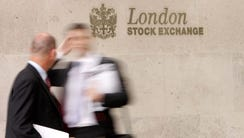 A 2007 file photo shows businessmen outside The London