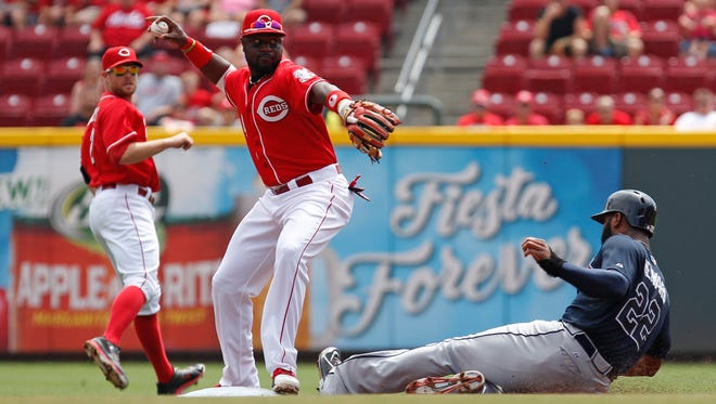Reds second baseman Brandon Phillips makes a play to put out Braves right fielder Jason Heyward during the first inning Sunday at GABP.