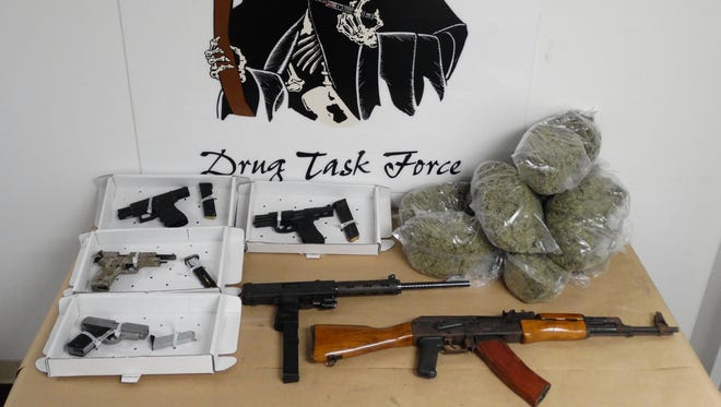 The Dutchess County Drug Task Force seized five loaded handguns, a loaded assault rifle and 10 pounds of marijuana during a search of 205 Winnikee Ave. in the City of Poughkeepsie Wednesday afternoon.