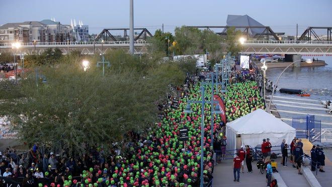Competitors prepare to enter the water during Ironman Arizona on Nov. 19, 2017 in Tempe, Ariz.