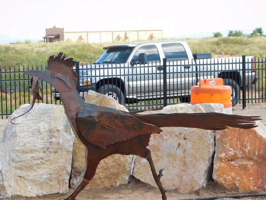 The medians now feature native plantings, accent boulders, meandering swales and the state bird of New Mexico in the form of a handsome roadrunner sculpture.