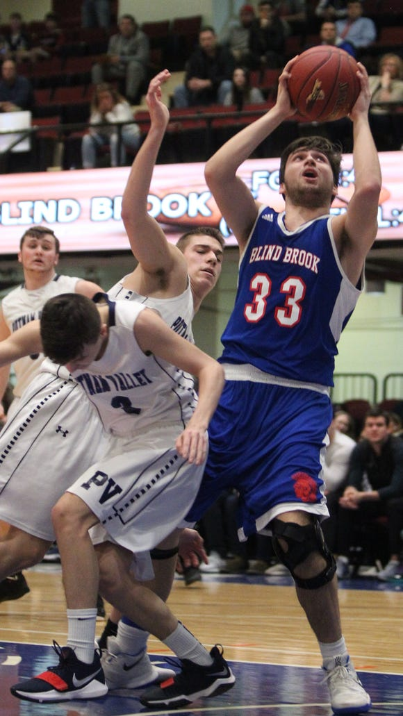 Blind Brook's Hudson Powell drives to the net during a Class B semifinal with Putnam Valley at the Westchester County Center Feb. 26, 2018.