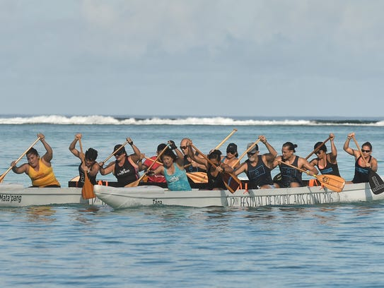 Paddling team #Unified Nation competes during the A.B.