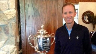 Brian Gaffney poses with the Wanamaker Trophy at the PGA Championship.