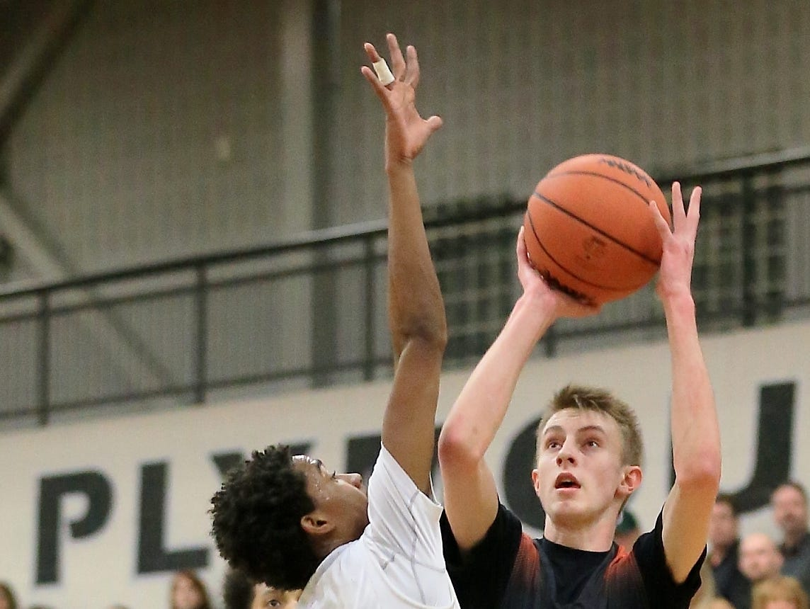 Northville 3-point sharpshooter David Morrissey (right) was named boys basketball All-Area Player of the Year.
