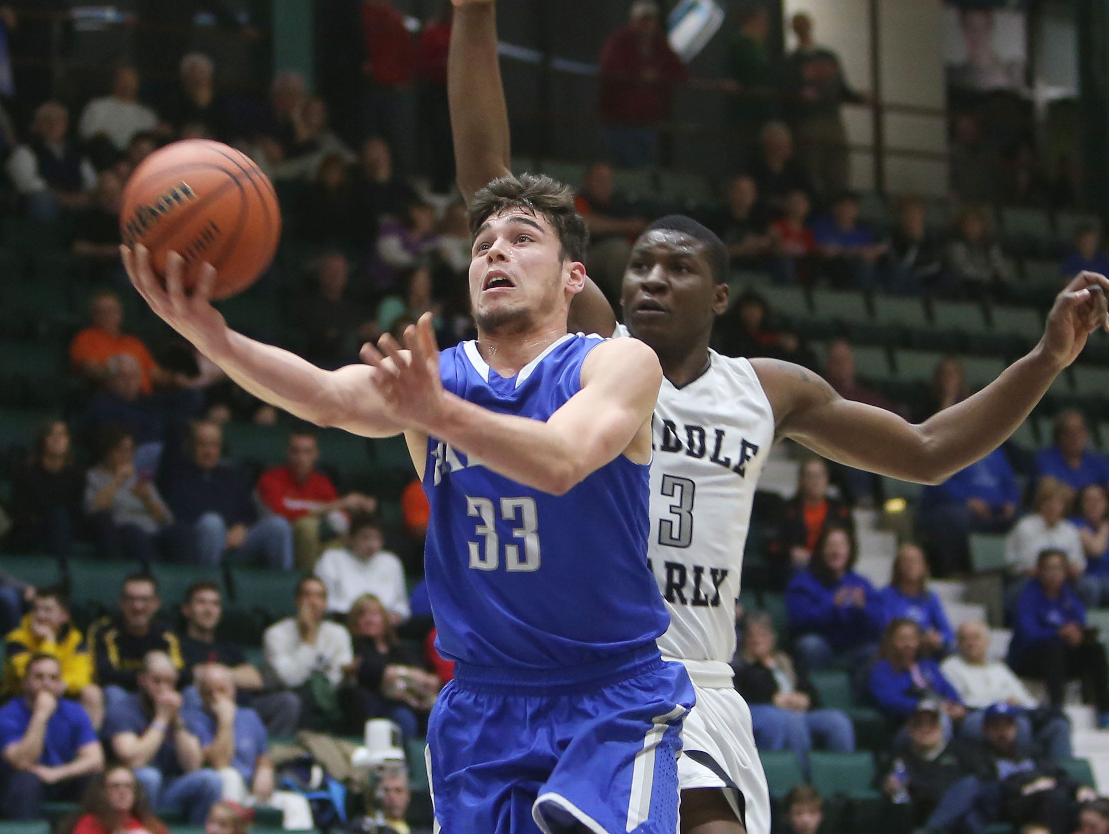 Haldane's Will Zuvic (33) tries to drive to the basket in front of Middle Early College's Gary Foster (3) during the New York State boys basketball Class C championship game at the Glens Falls Civic Center March 12, 2016. Middle Early College won the game 82-42.