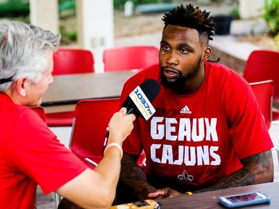 UL wide receiver Jamal Robinson speaks to members of