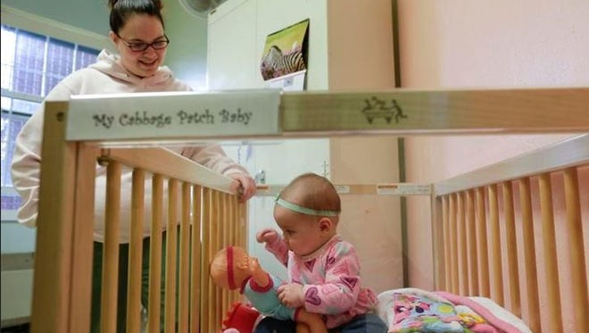 Jennifer Dumas watches her daughter, Codylynn, play in her crib inside her room at Bedford Hills Correctional Facility, in Bedford Hills, April 12, 2016.  Bedford Hills has one of only eight working prison nurseries where women live with their babies, out of more than 100 women's prisons around the country.
