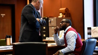 Defense attorney Michael Rubas, left, speaks with his client Basim Henry, right, during the fourth day of trial in the Essex County Superior Court on Wednesday, March 22, 2017. Henry is one of four men charged in the murder of Dustin Friedland during a Dec. 15, 2013 carjacking at the Mall at Short Hills.