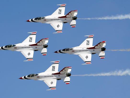 """The U.S. Air Force Thunderbirds perform the """"Diamond"""