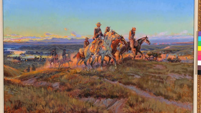 """C.M. Russell painted """"Men of the Open Range"""" in 1923, showing riders leaving behind a cow camp at daybreak. The painting is a romantic homage to bygone days."""