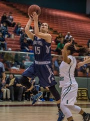 Piedra Vista's Dani Russo puts up a shot against Farmington on Thursday at the Chieftain Pit in Shiprock.