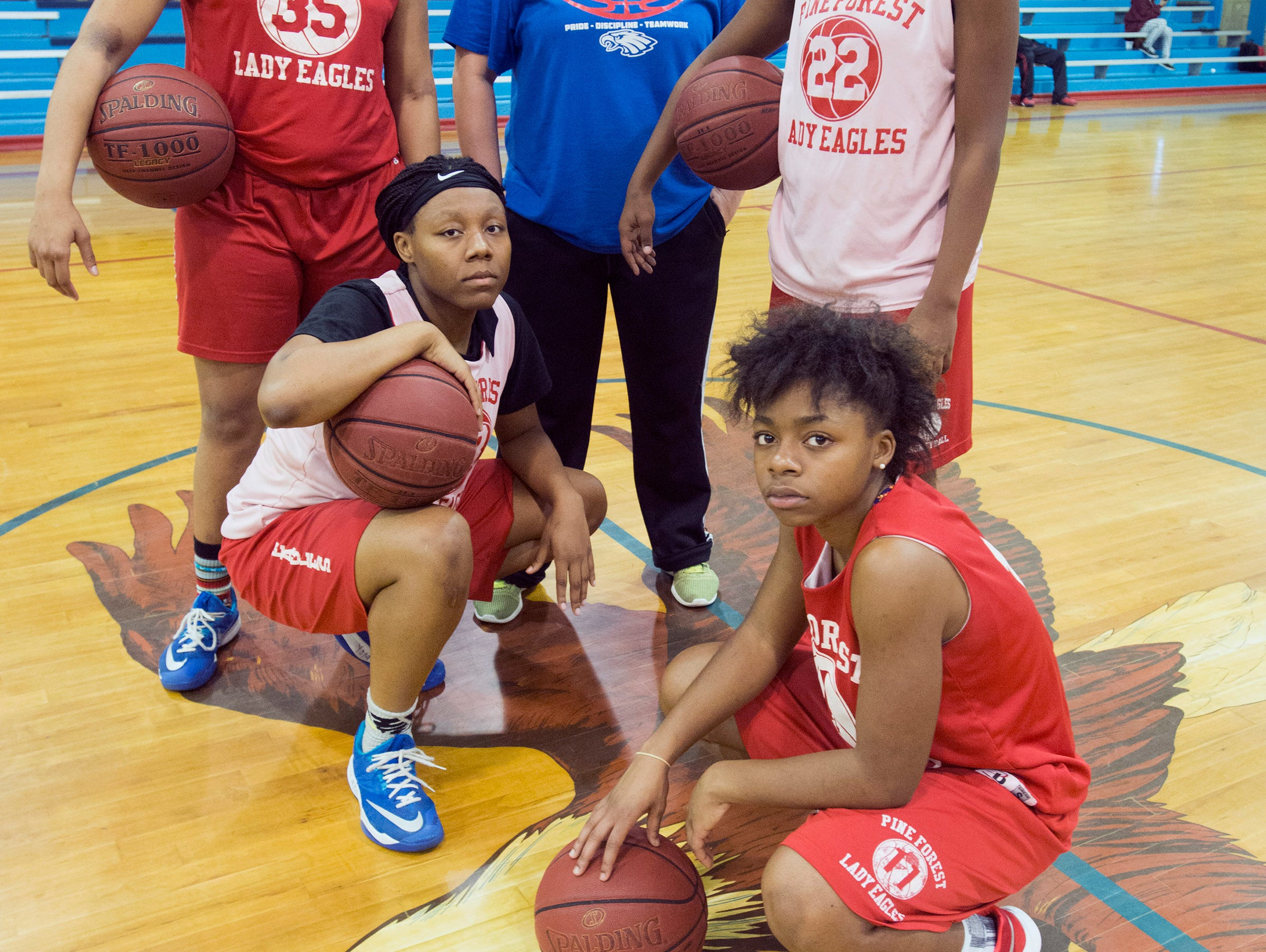 Pine Forest High School Girls Basketball coach, Zaria Williams, center, is rebuilding the Lady Eagles program with help from players Kim Payne, (No. 33), Bryanna Snowden, (No. 35), Destiny Ervin, (No .22) and Yeisha Taylor, (No. 11).