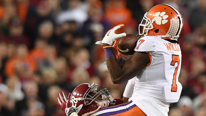 Clemson wide receiver Mike Williams (7) catches a pass over Alabama defensive back Anthony Averett (28) during the Tigers' winning drive against Alabama in the fourth quarter of the national championship game at Raymond James Stadium in Tampa on Jan. 9.