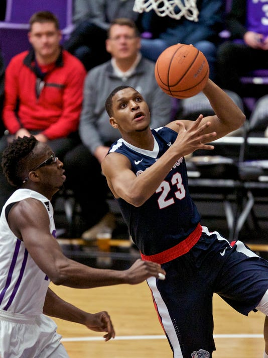 Gonzaga guard Zach Norvell Jr., right, shoots next to Portland forward Tahirou Diabate during the first half of an NCAA college basketball game in Portland, Ore., Thursday, Jan. 25, 2018. (AP Photo/Craig Mitchelldyer)