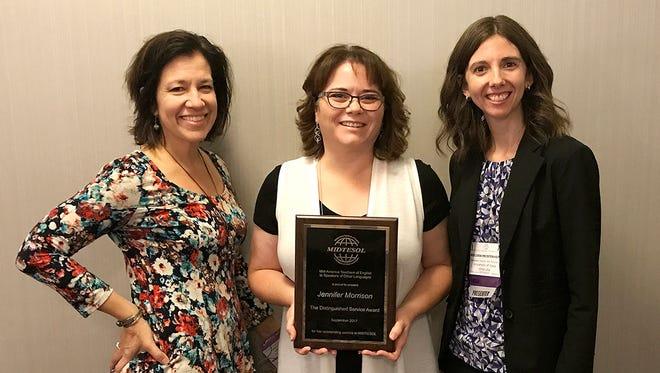Jennifer Morrison (center) proudly displays her award with Denise Mussman, MIDTESOL awards chair, and Melissa Meisterheim, MIDTESOL president.