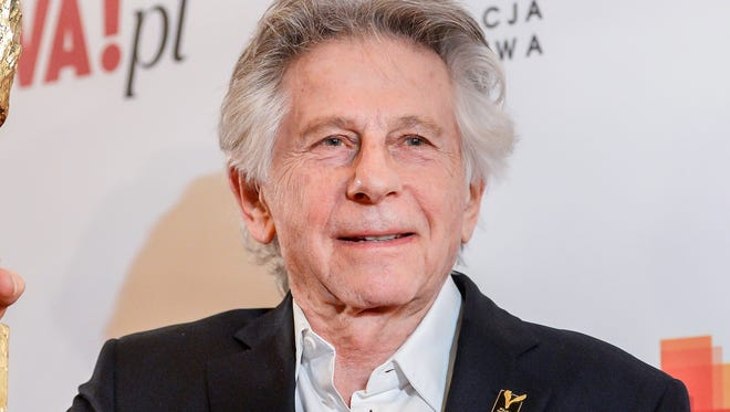 Director Roman Polanski poses with an award he received for his Oscar-winning movie 'The Pianist' during the Polish Film Awards in Warsaw, Poland, March 26, 2018.