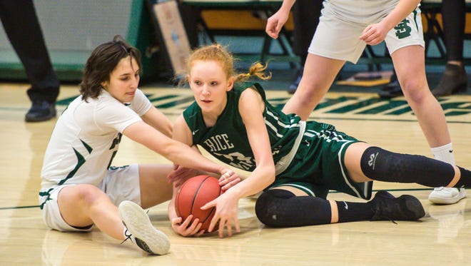 Rice Memorial's Lizzy Lyman, right, fights for the ball against St. Johnsbury's Sadie Stetson as Stetson's teammate, Neva Bostic, looks on during the Division I high school girls basketball semifinals earlier this month.