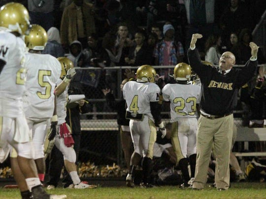 Newark coach Butch Simpson gets emotional during a 2011 game.