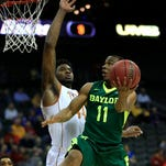 Baylor guard Lester Medford (11) shoots over Texas center Prince Ibeh (44) during the first half of an NCAA college basketball game in the quarterfinals of the Big 12 conference tournament in Kansas City, Mo., Thursday.