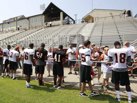 In this Aug. 18, 2011 photo, Bengals players sign autographs
