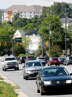 """Drivers travel on Hendersonville Road in South Asheville July 8. South Asheville resident Pat Deck said some residents there are """"on the lookout for a good candidate"""" from that area to serve on council."""