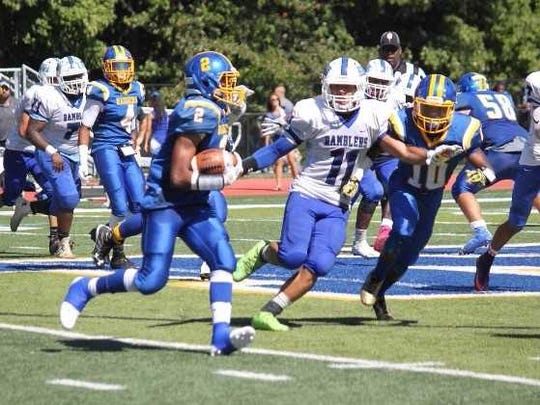 North Brunswick High School running back Myles Bailey looks for yardage against Carteret in a game last weekend.