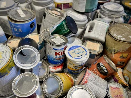 A bin of latex paints awaits proper disposal Thursday, May 29 at the Stearns County Hazardous Waste Facility in Waite Park.