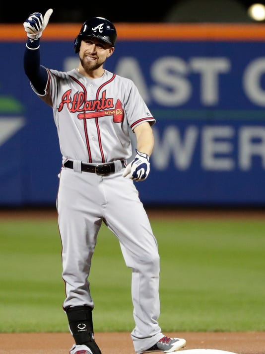 Atlanta Braves' Ender Inciarte gestures to the Atlanta dugout after hitting a double during the first inning of a baseball game against the New York Mets on Tuesday, Sept. 26, 2017, in New York. (AP Photo/Frank Franklin II)