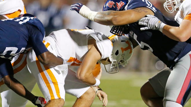 Tennessee quarterback Justin Worley was sacked seven times by Mississippi, including this one by defensive tackle Robert Nkemdiche.