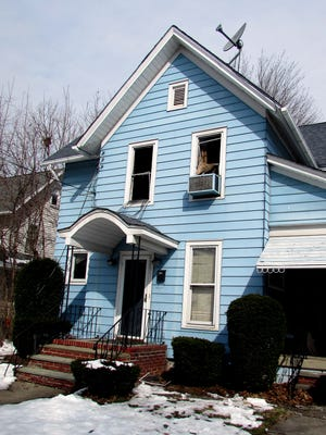 A 77-year-old woman died Friday night in a fire at this house on Baty Street in Elmira.