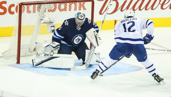Toronto Maple Leafs forward Patrick Marleau (12) scores against Winnipeg Jets goalie Steve Mason (35) during the second period at Bell MTS Place.