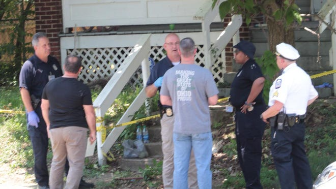Investigators gather outside a home on Linden Avenue in North Linden where a man and woman were found dead inside Monday morning.
