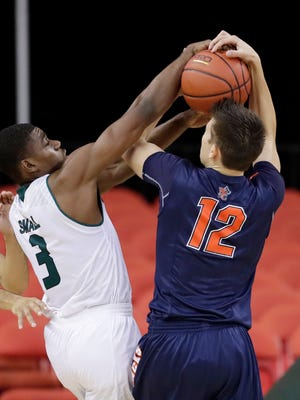 Green Bay Phoenix guard Khalil Small (3) fights for a rebound against Northland College's Matt Zorn (12) in a college basketball game at the Resch Center on Saturday, November 12, 2016, in Ashwaubenon, Wis. Adam Wesley/USA TODAY NETWORK-Wisconsin