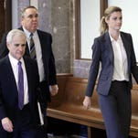 Sportscaster and television host Erin Andrews walks to the courtroom with attorneys Bruce Broillet, left, and Scott Carr, center, Monday, March 7, 2016, in Nashville, Tenn. Andrews' $75 million lawsuit against the franchise owner and manager of a luxury hotel and a man who admitted to making secret nude recordings of her in 2008 is to be turned over to the jury Monday.