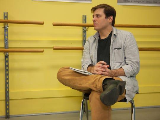 Seth Jarvis sitting in Chase Dance Studio on November