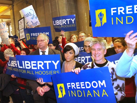 Opponents of HJR-3,  the proposed constitutional amendment to ban same-sex marriage in Indiana, hold up signs outside the House chambers where the House Judiciary Committee was holding a hearing to take testimony for and against it at the Indiana Statehouse on Monday, January 13, 2014. No committee vote was taken after public input.