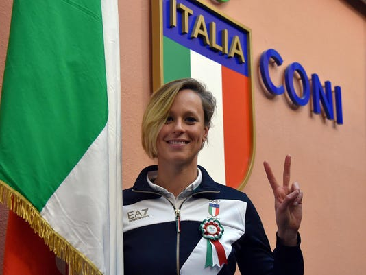 Swimming world-record holder Federica Pellegrini poses during a press conference in Rome, Wednesday, April 27, 2016. Pellegrini has been selected as Italy's flagbearer for the Rio de Janeiro Olympics. The Italian Olympic Committee made the announcement Wednesday, which marks 100 days until the opening ceremony on Aug. 5. (Ettore Ferrari/ANSA via AP Photo) ITALY OUT