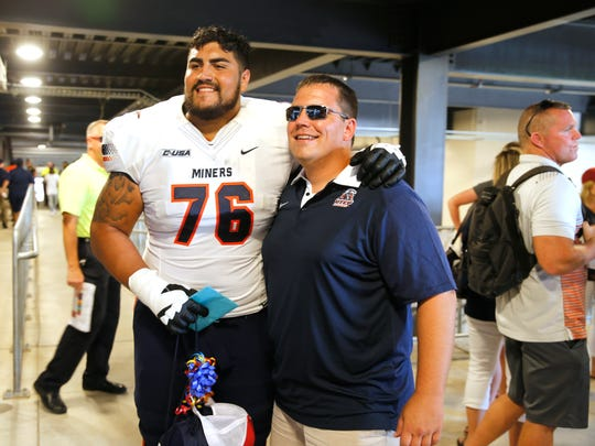 UTEP All-American Will Hernandez, left, shares a moment after the game with a fan, who stopped by after the game to wish him a Happy Birthday. Hernandez and his teammates lost to the Oklahoma Sooners 56-7 on Sept. 2, 2017. Hernandez is expected to be a first- or second-round pick in the 2018 NFL Draft.