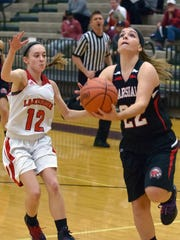 Marshall's Jill Konkle (22) drives the basket during this Class B regional semifinal on Tuesday.